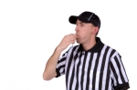 Football referee blowing whistle
