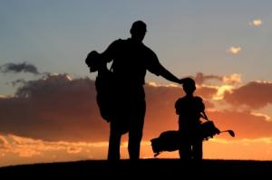 DAd & Son golfers_iStock_000004230306XSmall