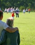 sideline parents arm around_iStock_000002126386XSmall